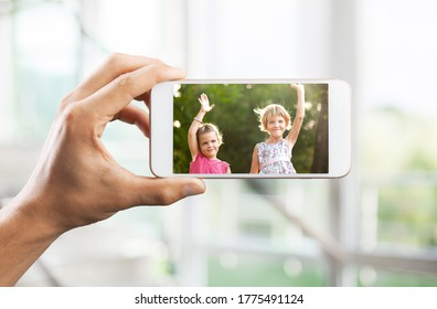 The human hands make a smartphone video call to the relatives while they are in quarantine