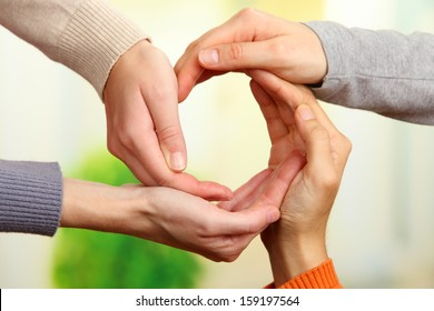 Human hands making circle on bright background