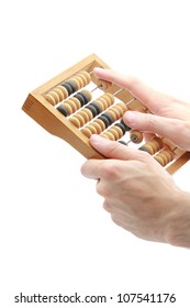 Human hands with old abacus