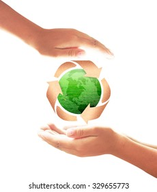 Human hands open for recycle arrow symbol made of old paper texture protecting green earth globe of grass isolated on white background. Recycle icon: Saving world environmental concept.
