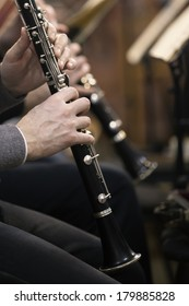 Human hands playing a clarinet closeup