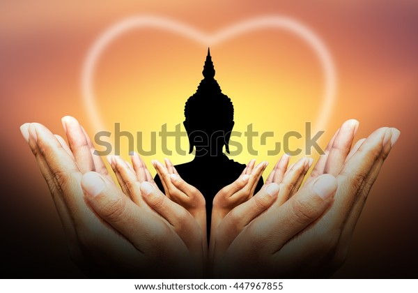 human hands Protect silhouette of Buddha