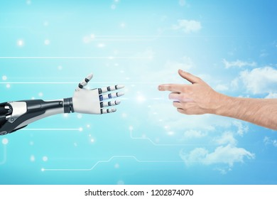 A human hands reaches to the white and black very detailed robotic hand on blue background. Technology advancements. Robotization trends. Future technology developments.