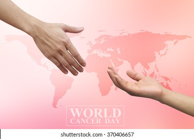 human hands reaching together for healing on world cancer day concept.