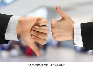 Human hands showing agree sign Versus disagree