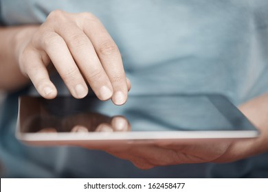Human hands working with digital tablet