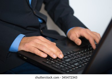Human hands working on a laptop. advertising or business concept, isolated on a gray background.