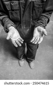 Human hands working on the production.  Mechanic powertrain. 54 year old
