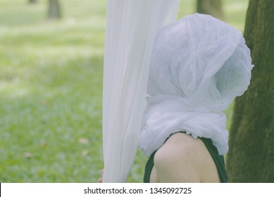 human head covered by white fabric