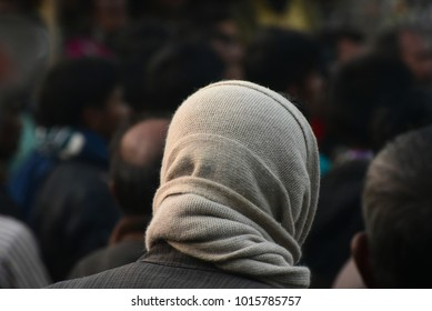 Human head covering with white scarf muffler in the crowd stock photograph
