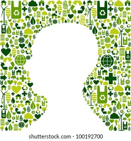 Human head silhouette made with green icons set background.