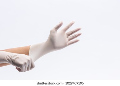 Human holding Variation of Latex Glove, Rubber glove manufacturing, human hand is wearing a medical glove, glove