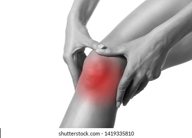 Human injured knee. Sore spot highlighted by red marker. Person touches his leg by hands. Close up, isolated on white. Trauma, pain, sport damage, overload, health care, medicine and surgery concept