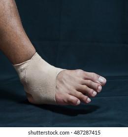 Human leg wrapped with white bandage