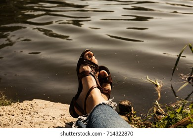 Human legs against the background of the river