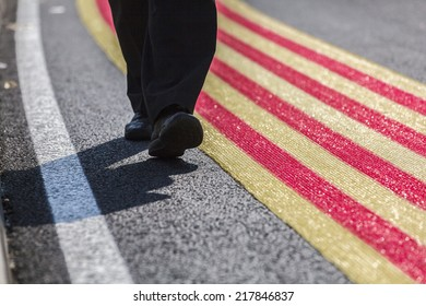 Human legs to walk around large catalan flag on the floor/ Catalan Way /Barcelona, September 11, 2014.