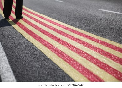 Human legs to walk around large catalan flag on the floor / Independence of Catalonia / Barcelona, 11 September, 2014