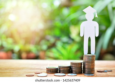 human model graduation set on money coins saving for concept investment education finance and scholarships