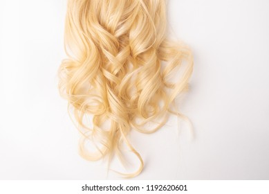 Human, natural light blond hair on white isolated background. An example of a fashionable hairstyle for a poster, an advertisement or a hairdressing website.