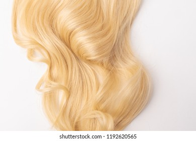 Human, natural light blond wavy hair on white isolated background. An example of a fashionable hairstyle for a poster, an advertisement or a hairdressing website.