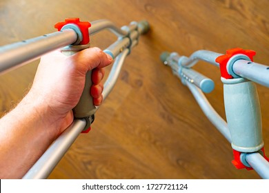 Human on crutches. Crutches from the first person. Rehabilitation after a broken leg. Crutches in the hands of man. Rehabilitation after an accident. Concept - a consequence of the road accident.