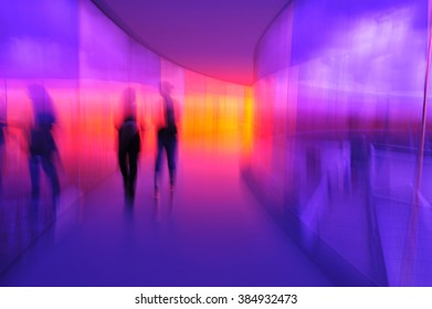"Human Reflections  ""Your Rainbow Panorama"" Aros, Aarhus, Denmark.  Walkway in glass in all the colours of the spectrum.  I moved the camera while taking this photo to make the image abstract."
