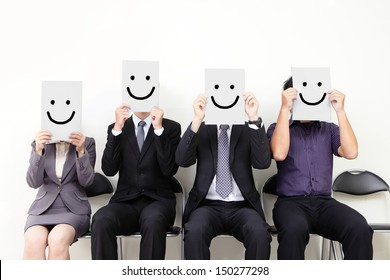 Human resource concept, Young businessman holding white billboard with a smile happy face on it and waiting for job interview, , asian people