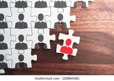 Human resource management. Creating successful organization.Personnel, employment and recruitment concept. Assembling jigsaw puzzle on wood desk.