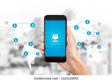 Human resource management or HRM application on smartphone screen with worldwide internet network connection graphic and icons in background