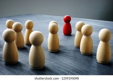 Human resource management. Looking for talented employee. Wooden figures on a desk.