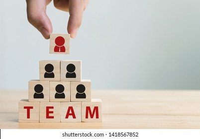 Human resource management and recruitment business team concept. Hand putting wood cube block on top pyramid