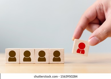 Human resource management and recruitment business concept. Wooden cube blocks are different with human icons, red, prominent crowds
