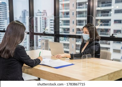 Human resource manager job interview, document submission of job applicants, conversations and  have plastic scenes protect Corona virus prevention Covid 19 disease. New normal concept.