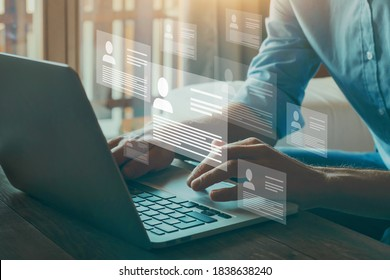 Human resource manager looking at many different cv resume and choosing perfect person to hire. HR concept on virtual screen.