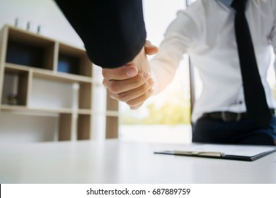 human resource recruiter handshaking with candidate