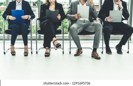Human resources management concept - Business man and business woman sitting in office waiting for interview with the human resource manager.