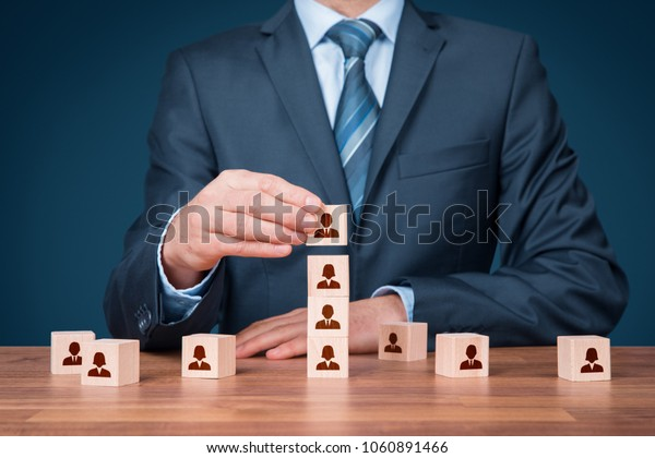 Human resources officer install one person as team leader. Team composition, team configuration, teamwork, cooperation and team leader (CEO) concepts.