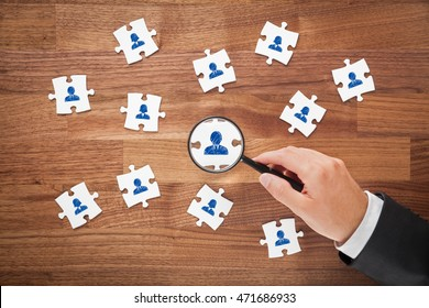 Human resources as peace of puzzle, personal audit and assessment center concept - recruiter look for employee ideal for team represented by icon.