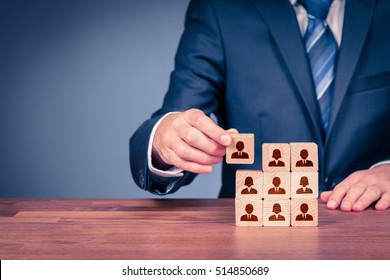 Human resources, social networking, assessment center concept, personal audit or CRM concept - recruiter complete team by one person. Employees are represented by wooden cubes with icons.