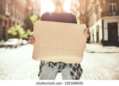Human rights. Cropped image of young woman holding a blank signboard while standing on the road.