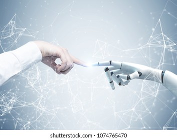 Human and robot hands reaching out and touching with index fingers. A gray background with a network hologram. Concept of hi tech