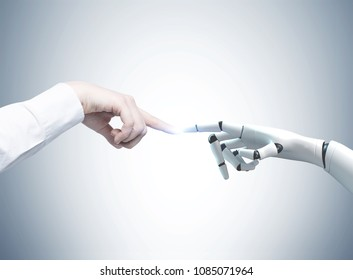 Human and robot hands reaching out and touching with index fingers. A gray background. Concept of hi tech