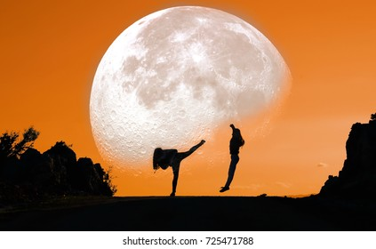 Human silhouettes and moon in the mountain