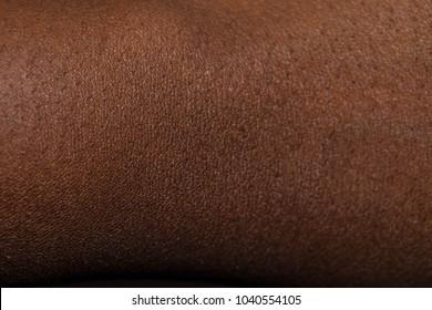 Human skin texture: Dark Brown African Skin texture