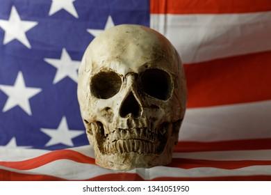 Human skull against american flag closeup photo