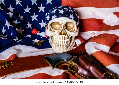 human skull with american flag skull cap and leather holster with black revolver on american flag