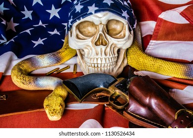 human skull with american flag skull cap and leather holster with black revolver and large yellow snake on american flag