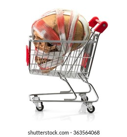 Human skull bind with blood stain bandage inside shopping cart isolated on white