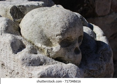 Human skull with bones carved in stone