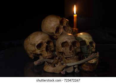 Human skull in candlelight